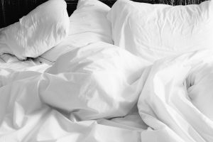 White pillows and sunbeam electric blanket