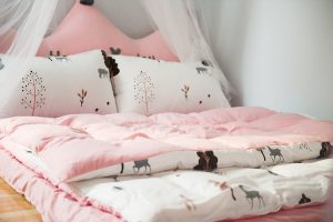 pink bed with a memory foam topper