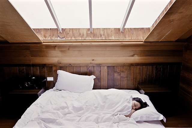a woman sleeping on bed